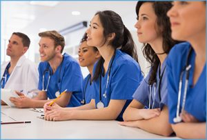 Oncology professionals or students in a classroom.