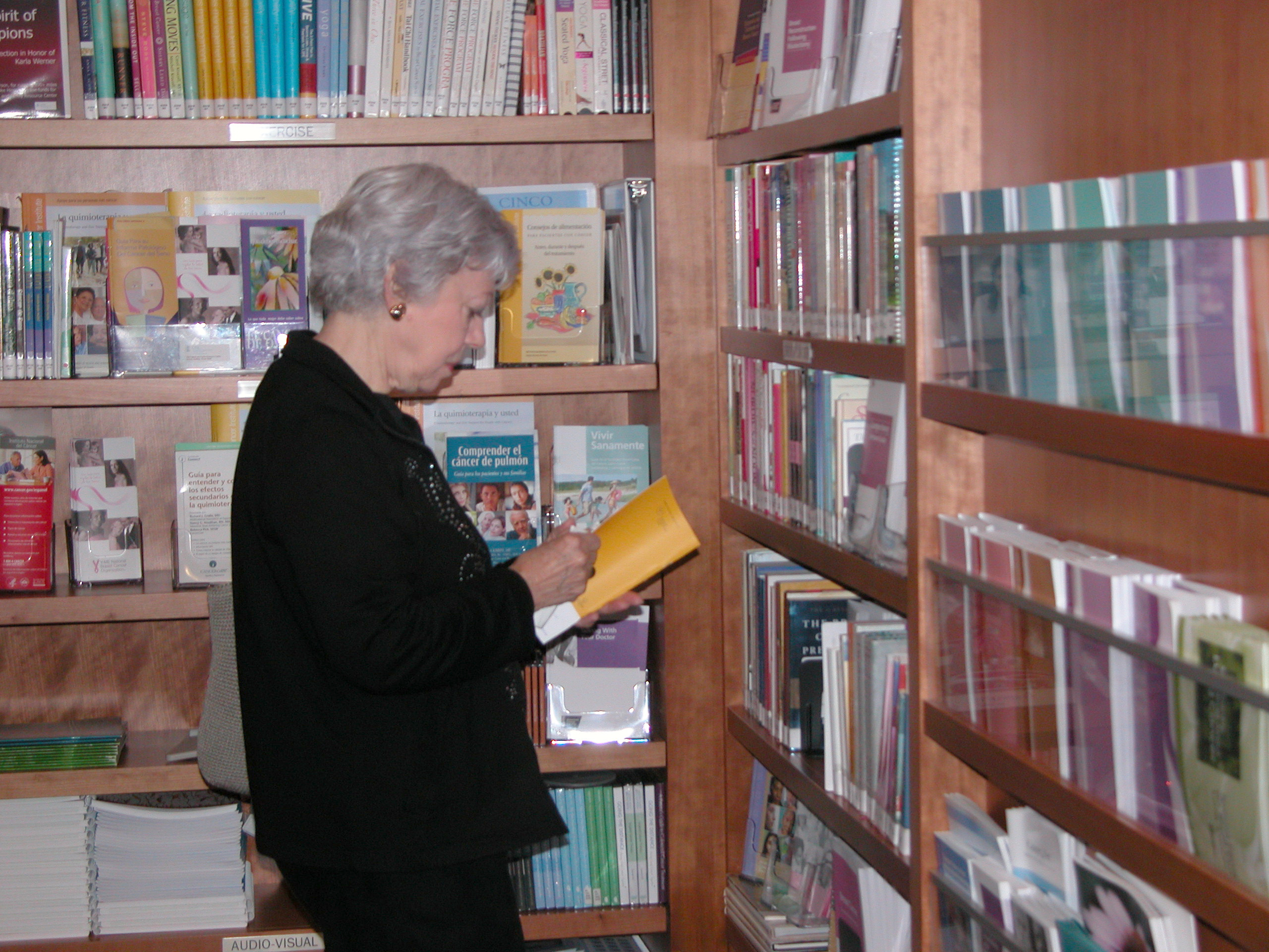 Photo of person reading book in PFRC education section