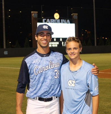 Benton and Liam on the field at Boshamer Stadium this spring. Liam credits Benton and Chase with encouraging him to reach out to other kids fighting cancer.