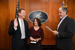 Norman E. Sharpless, MD, accompanied by his wife, Julie Sharpless, MD, is sworn in as NCI director by Acting Secretary of Health and Human Services Eric D. Hargan.