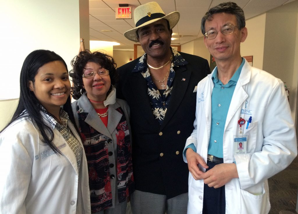 "Veatrice Harris calls her team of caregivers her ""UNC family."" (L to R) Monique Clayton, RN, BSN, clinical trials study coordinator; Veatrice Harris; her husband Jonathan Harris; and Jack Zhang, RN, BSN, clinical trials study coordinator."