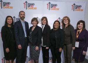 Members of the newest Meg Vosburg T-Cell Lymphoma SU2C Dream teams group photo during a break in sessions
