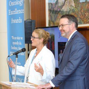 Lisa Carey, MD, introducing an award recipient