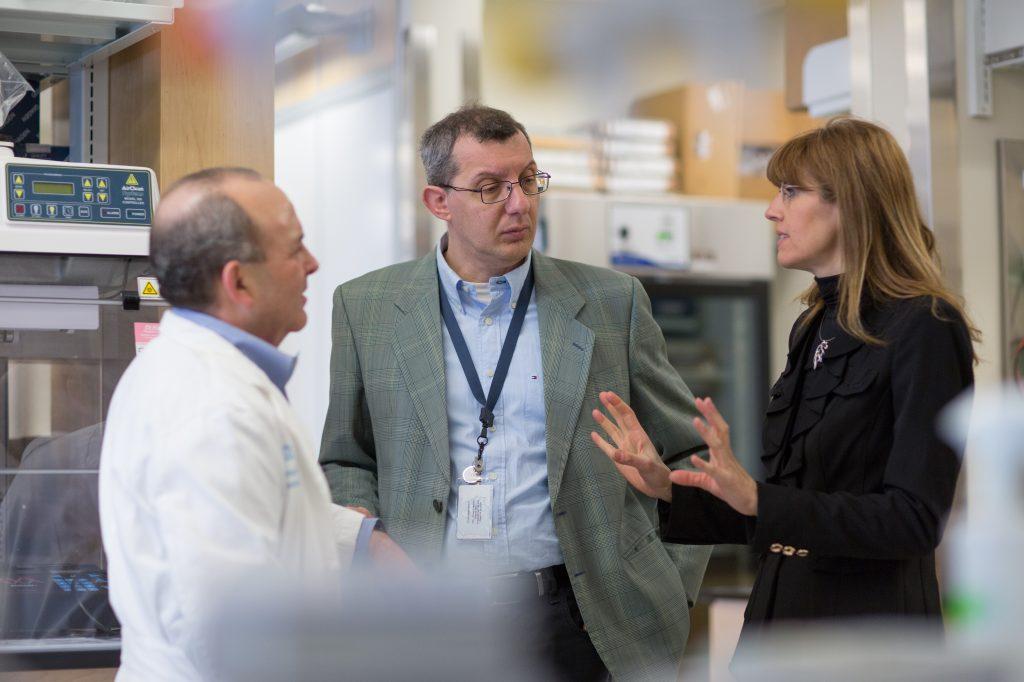 Jonathan Serody, Gianpietro Dotti and Barbara Salvado in a lab.