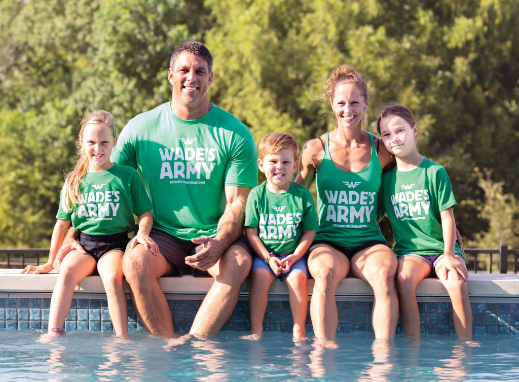"The Welbourn family wearing green t-shirts with printed text ""Wade's Army"""