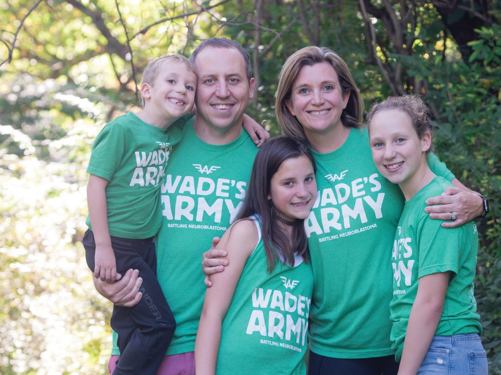 "The Debruin family wearing green t-shirts with printed text ""Wade's Army"""