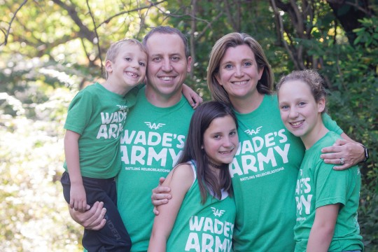The Debruin family wearing green t-shirts with printed text