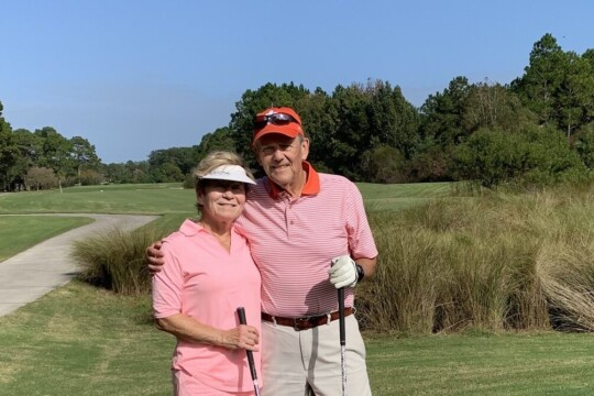 Barry Wetzel with his wife Susan on a golf course.